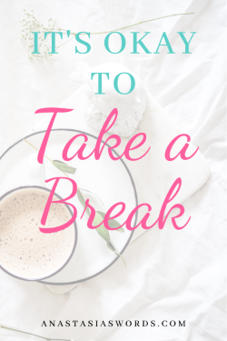 a cup of coffee, icecream, and leaves on a white bed spread with a text overlay that says it's okay to take a break. anastasiaswords.com