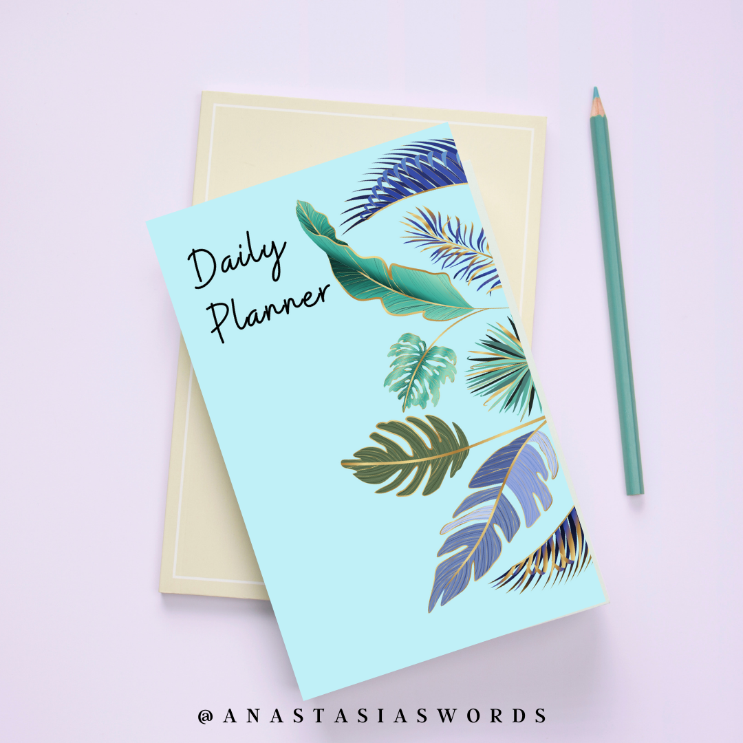 Daily planner on another book with a pencil next to it
